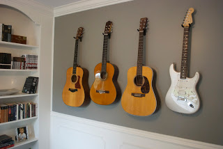 Guitars Hangig On Wall