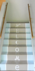 stairs blue and grey with welcome stenciled