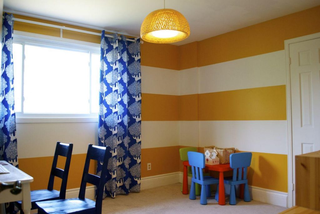stripe painted on toy room walls