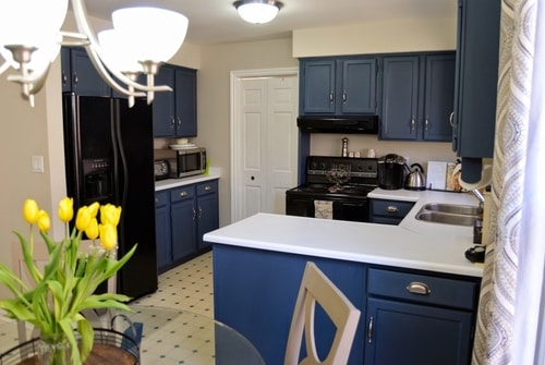 kitchen cabinets painted with navy chalk finish paint black appliances