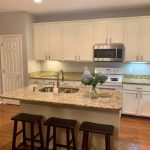 painted kitchen cabinets with island and bar stools