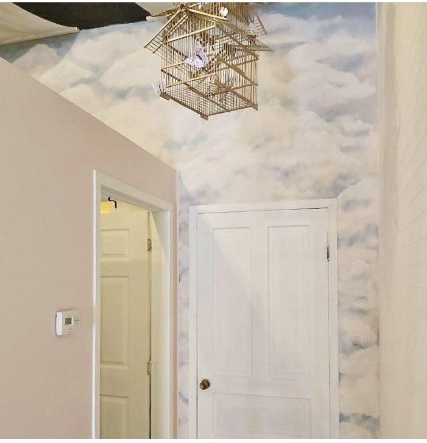 clouds painting on loft wall