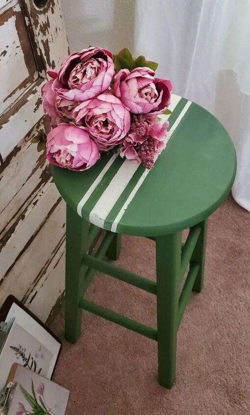 green stool with white stripes